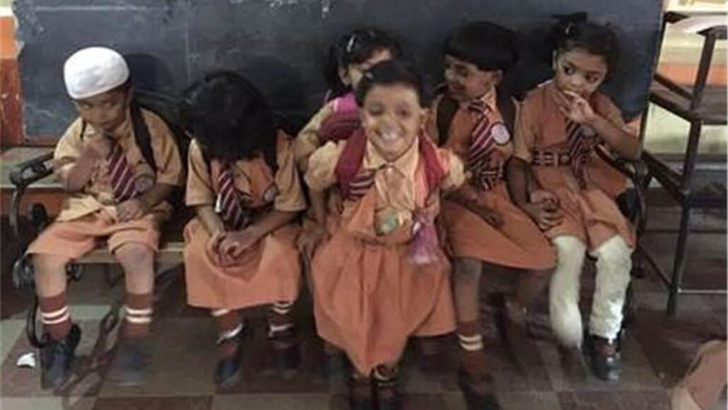 Schoolchildren smile at camera
