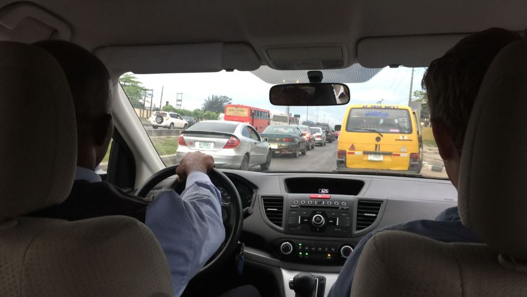 view of an airport road from inside a car