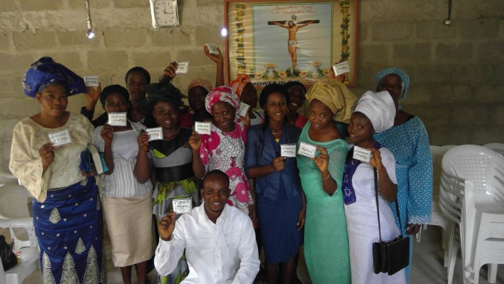 A group of women in Nigeria holding up their packages of tampons