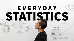Man looking at statistics on whiteboard.