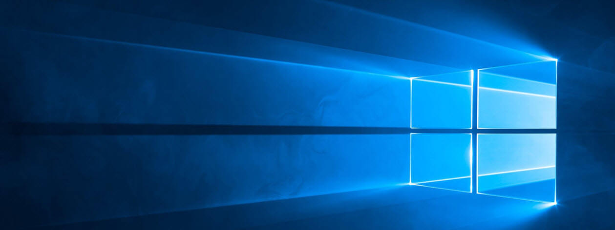 Windows logo on PC wallpaper.