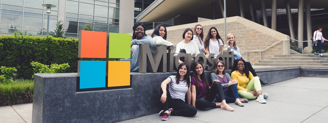The ten 2018 Grace Hopper Award winners standing in front of the Microsoft sign on the Redmond campus.