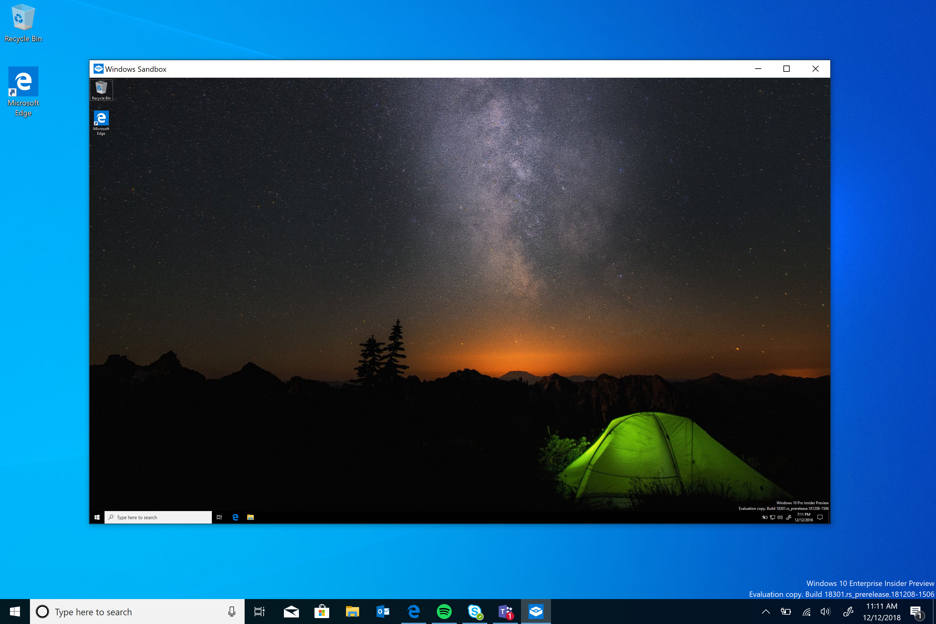A Windows Sandbox VM window open on a user's normal desktop.