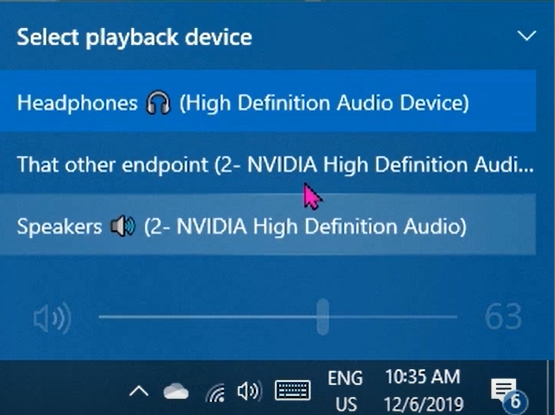 Selecting your playback device from the volume flyout of the taskbar.