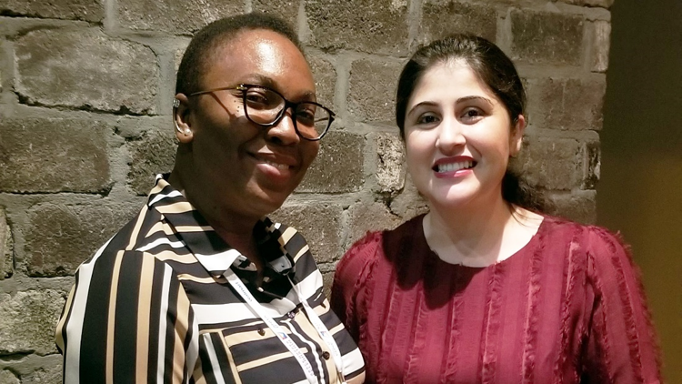 Nonye, on the left, with her new mentor Muazma, on the right, smiling for the camera at GHC 2019.